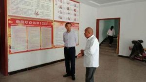 An official from Huiting town in Xiayi county is inspecting a religious venue.