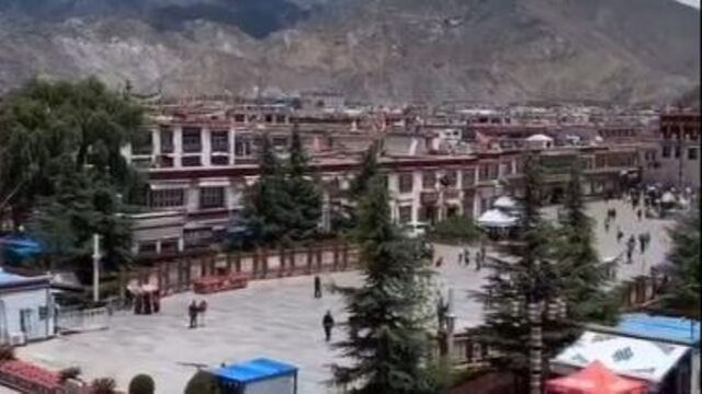 People line up at a checkpoint controlling access to Barkor Square in front of the Jokhang temple in center city Lhasa. Screen shot from video of WeChat account, accessed August 27, 2019. Copy of video on file.
