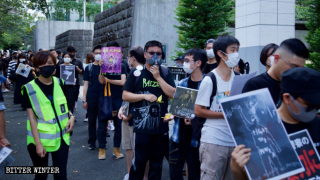 Marchers wear gas masks, as a sign of protest against Hong Kong police violence.