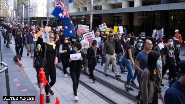 More than 1,000 supporters of the Hong Kong protests march on the streets of Sydney.